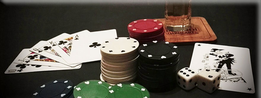 Online Casino Chips, dice and cards on the table
