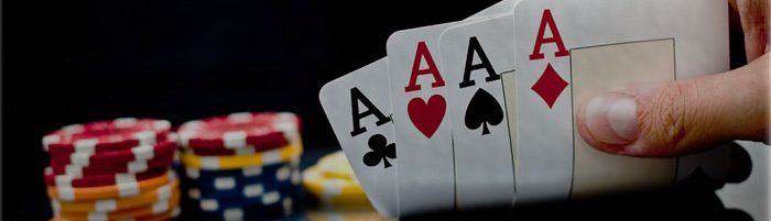 Poker Hand holds cards and chips on the background